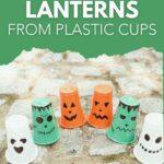 Halloween character lanterns on cobblestone