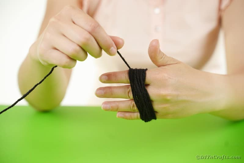 Wrapping yarn around hand