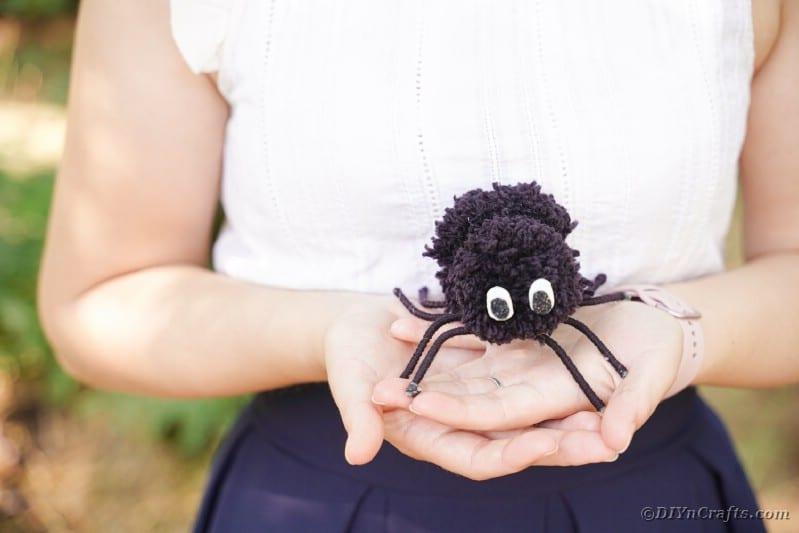 Woman holding a pom pom spider
