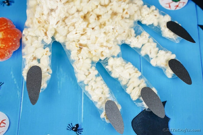 Popcorn hand on blue surface