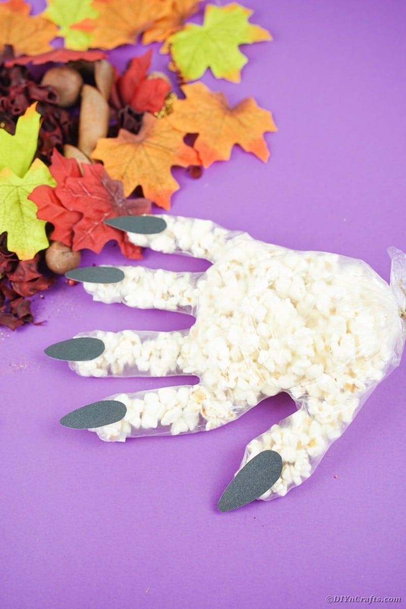 Popcorn hand on purple surface