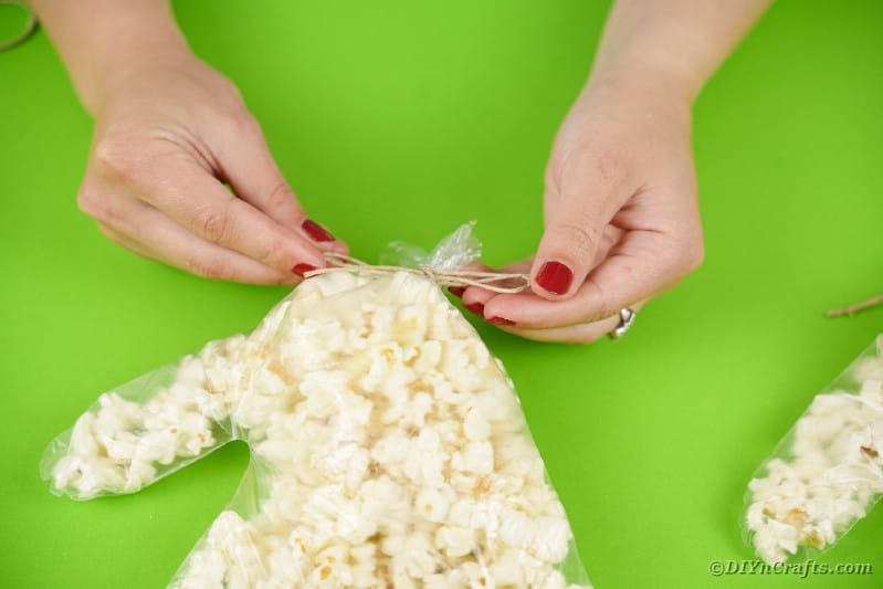 Tying end of popcorn hand
