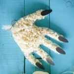 Popcorn hands on blue wood surface