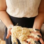 Woman holding popcorn hand