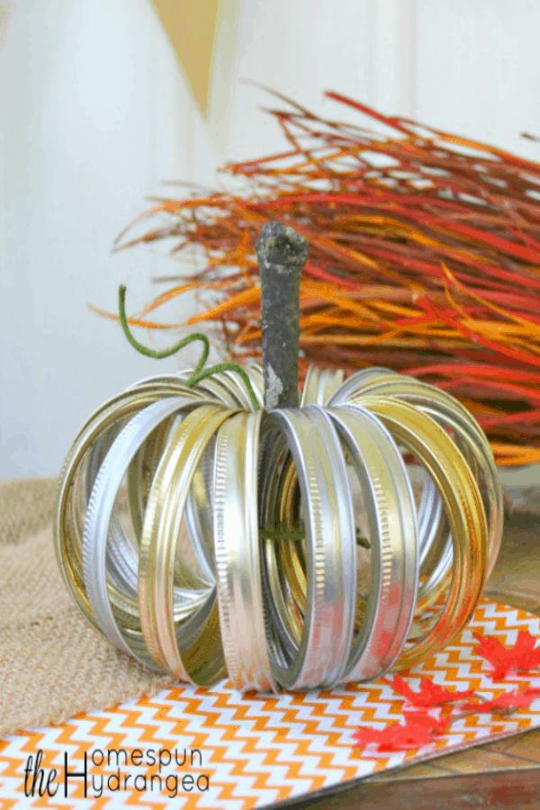 Mason jar lid pumpkin on table