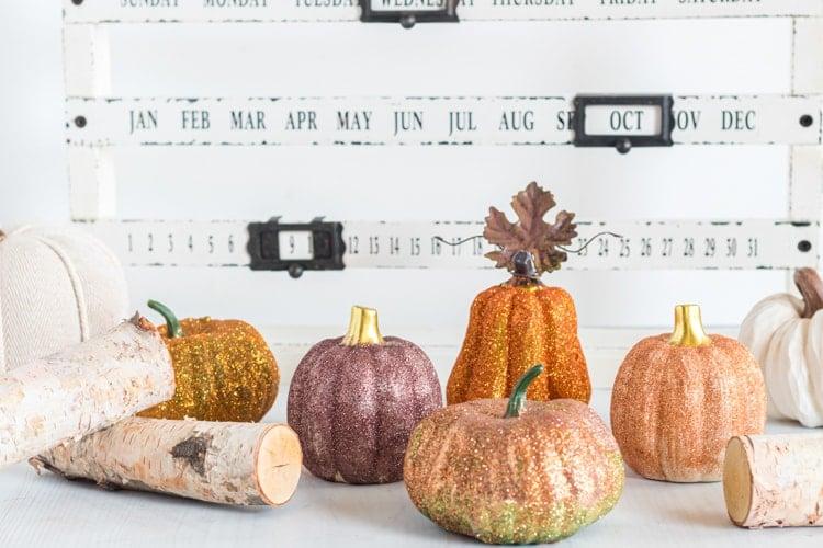 Glitter pumpkins in front of calendar