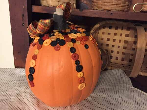 Buttons on plastic pumpkin