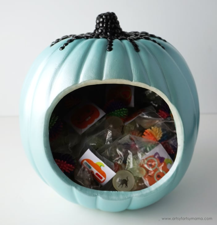 Teal pumpkin filled with treats