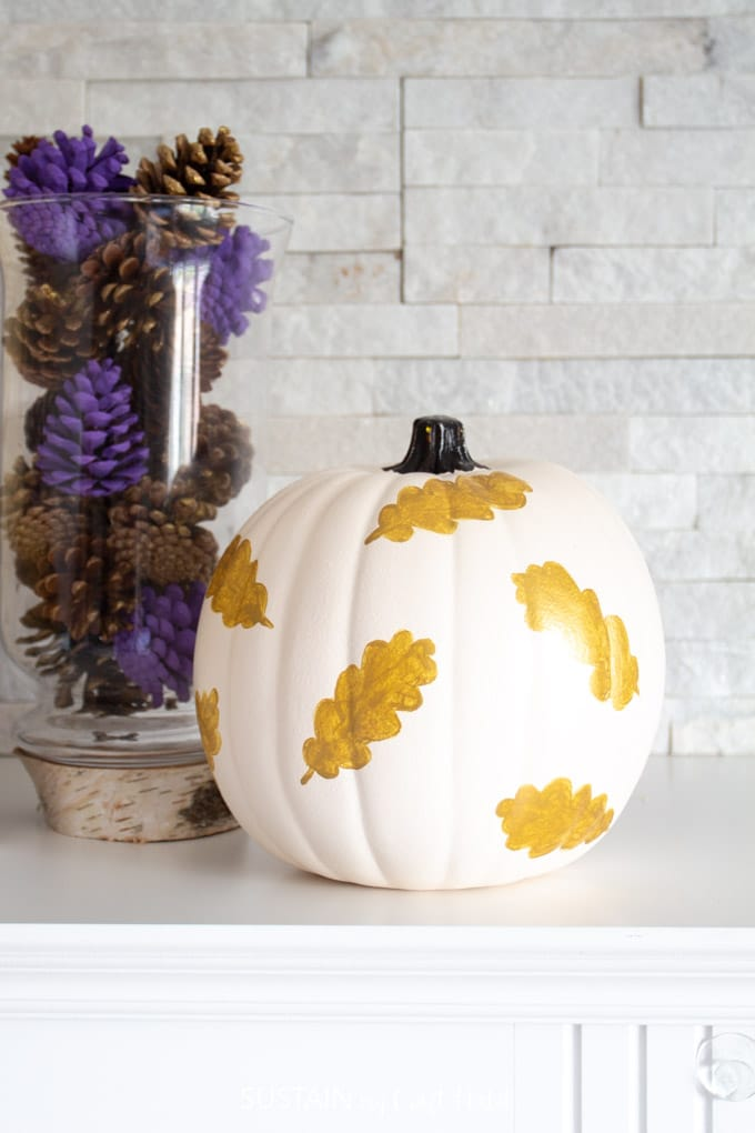 White pumpkin with gold leaves