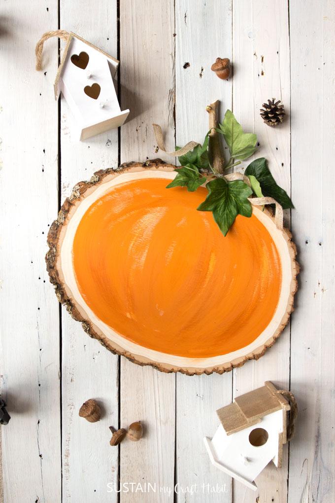 Pumpkin painted on wood slice