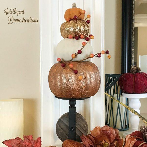 Fall colored pumpkin topiary