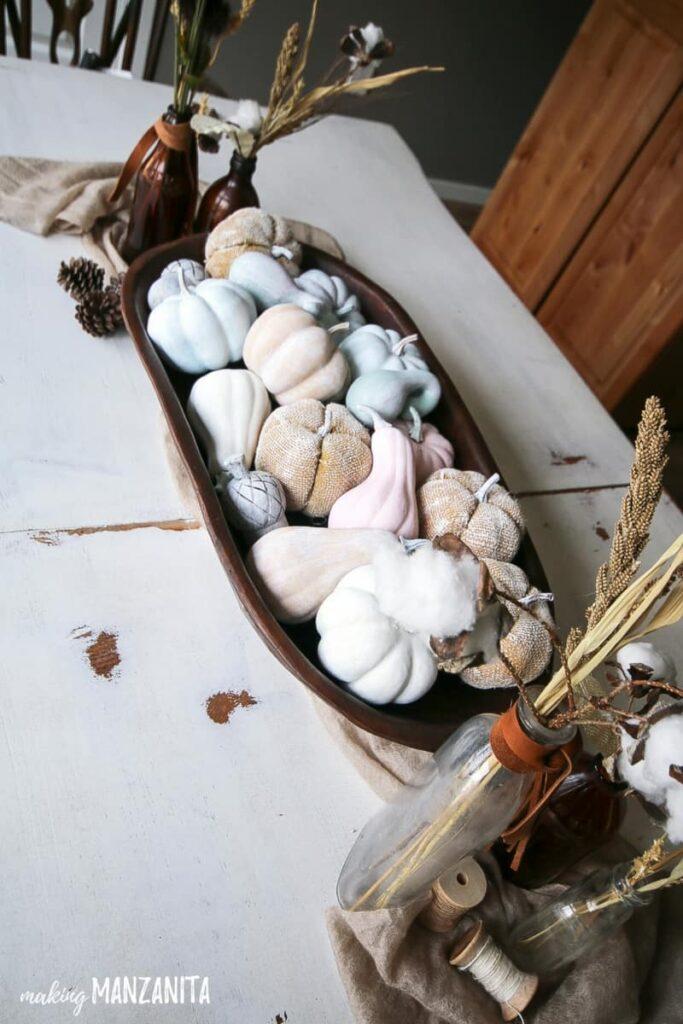 Pastel pumpkins in wood tray