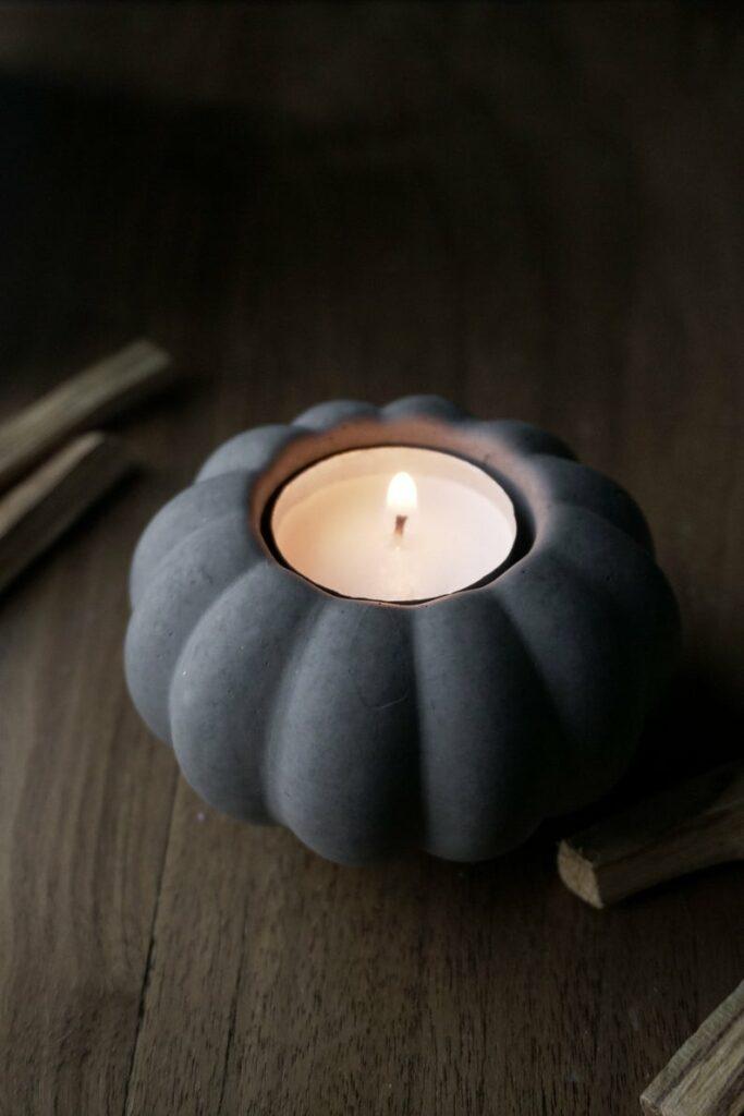 Concrete pumpkin with candle lit
