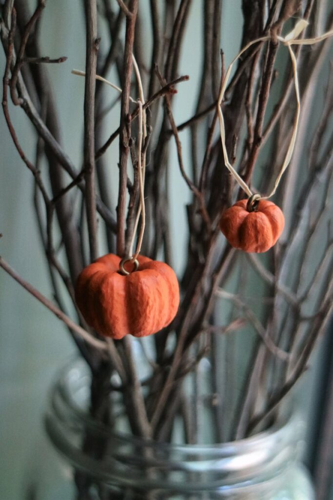 Pumpkin ornament in bare branches
