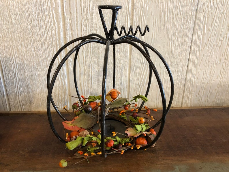 Metal pumpkin on table