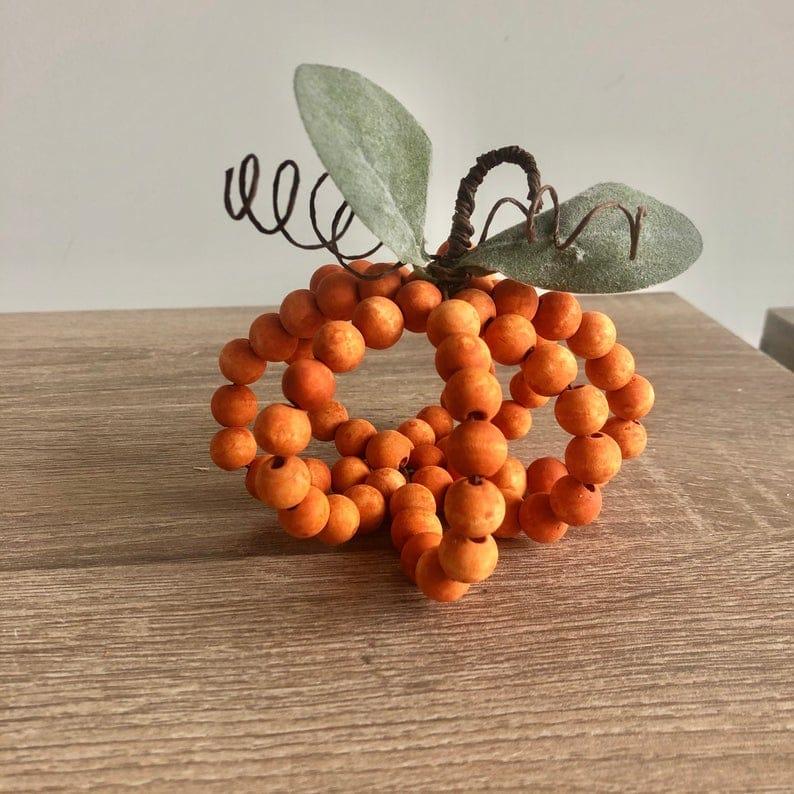 Bead pumpkin on table