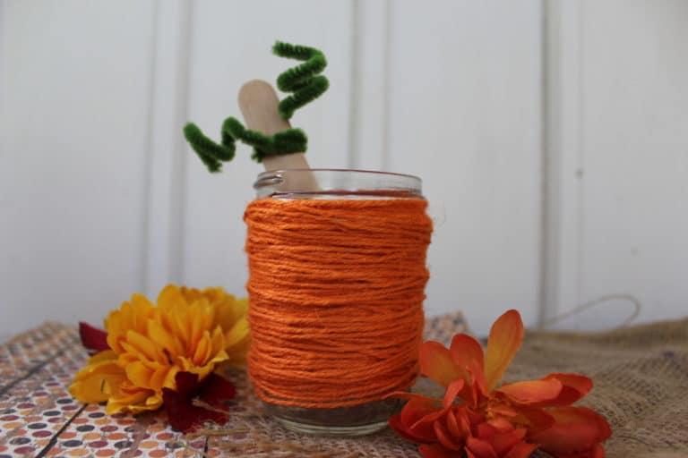 Orange twine wrapped mason jar on table
