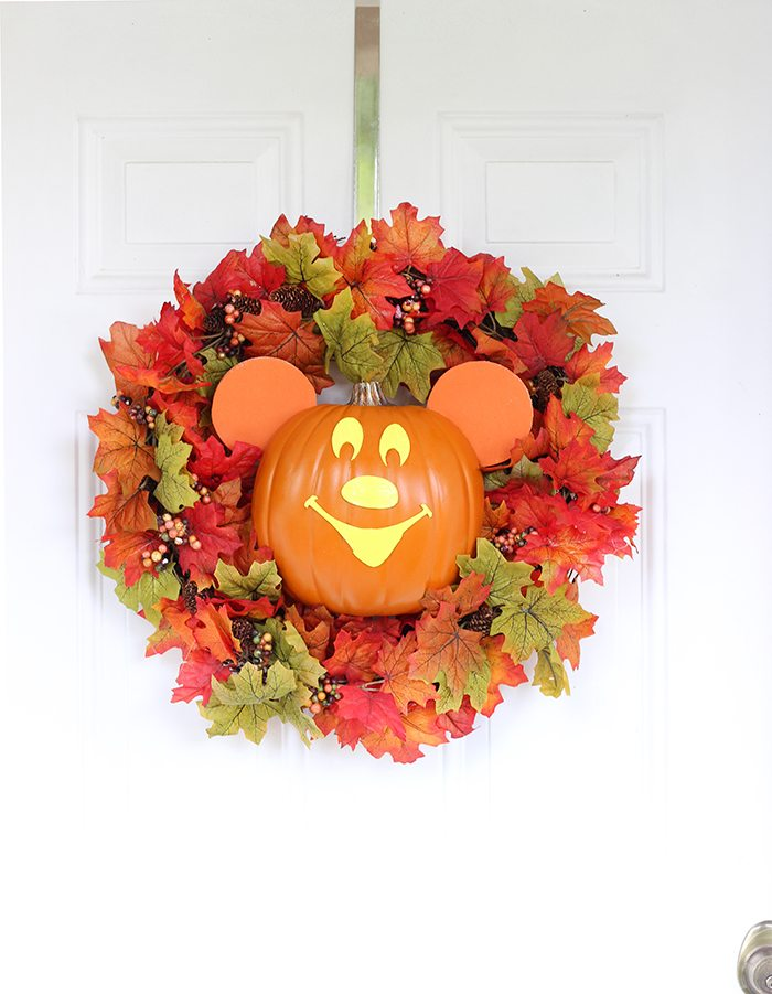 Mickey pumpkin wreath on whtie door