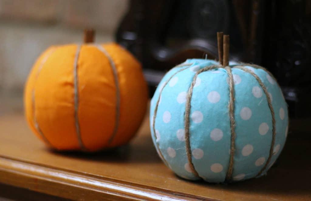 Blue and orange fabric pumpkin on shelf