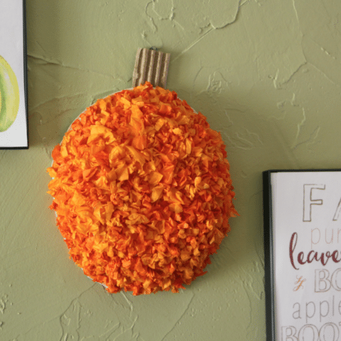 Tissue paper pumpkin on wall