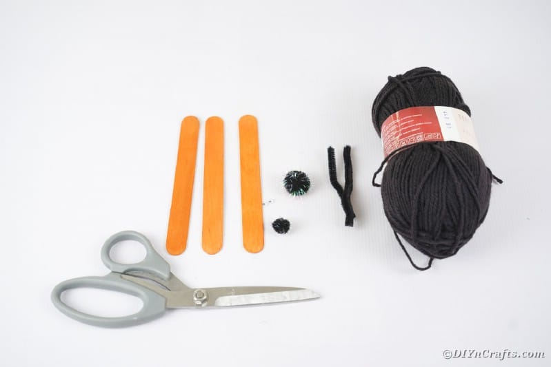 Supplies for craft stick spider web