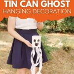 Woman holding a tin can ghost decoration