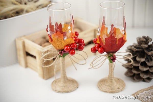 Wedding stemware by wooden box of fall decor