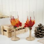 Wedding stemware by wooden box of fall decor