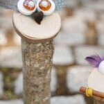 Tall wooden owl on cobblestone