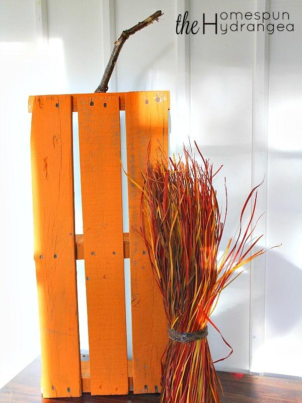 Pallet pumpkin against wall