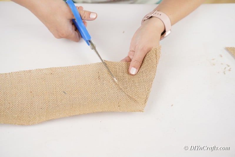 cutting burlap with scissors