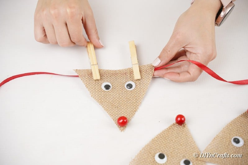 reindeer with piece of ribbon