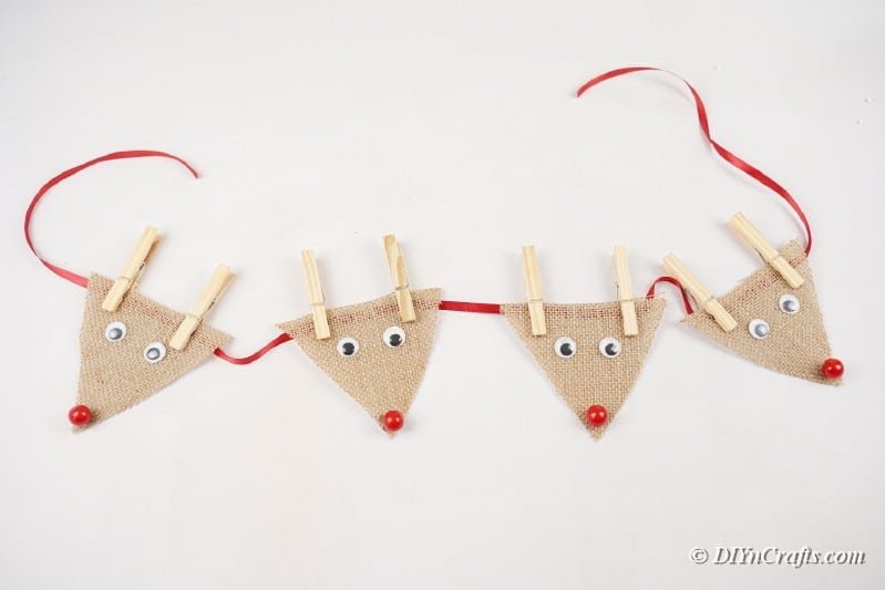 reindeer burlap arranged on a piece of ribon