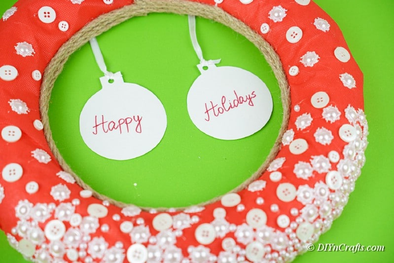 large wreath perfect for hanging with craft buttons