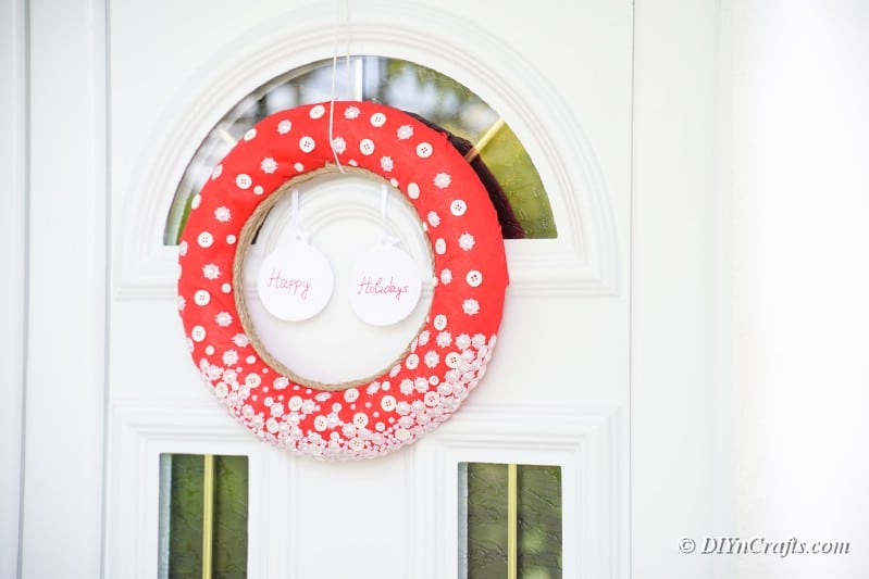 button christmas wreath on front door