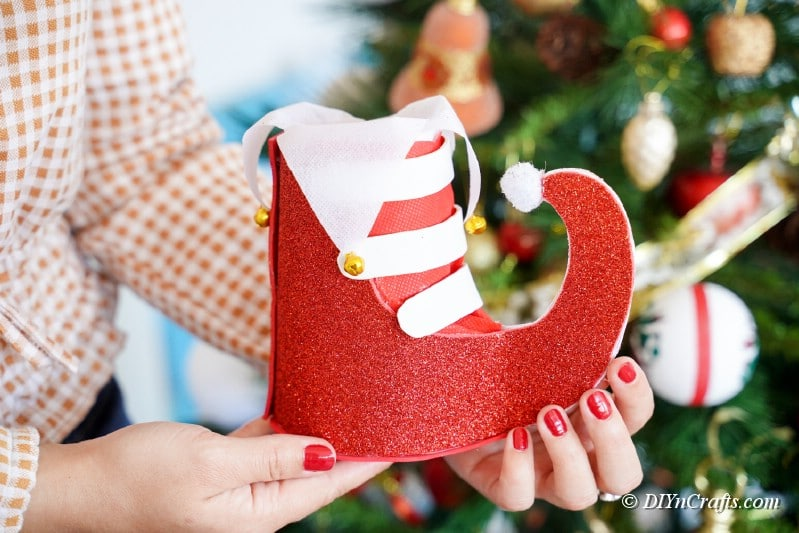 woman holding craft Christmas boot decoration