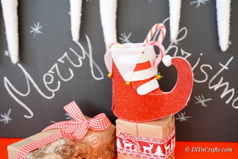 craft foam boot sitting in front of chalkboard display
