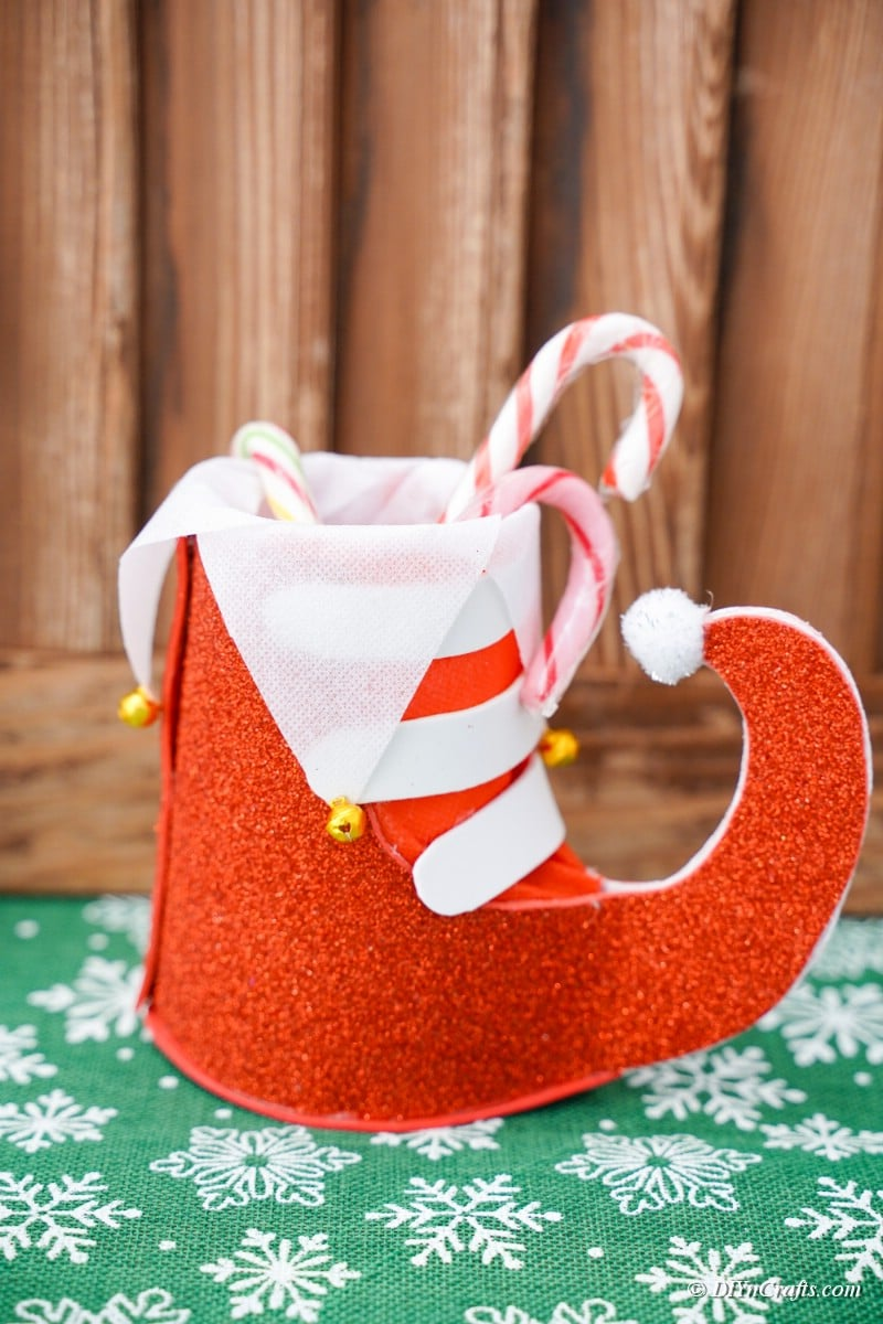 crafted santa boot against wooden wall