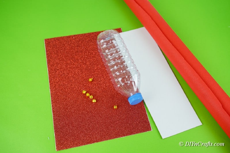 craft supplies on table water bottle wrapping paper