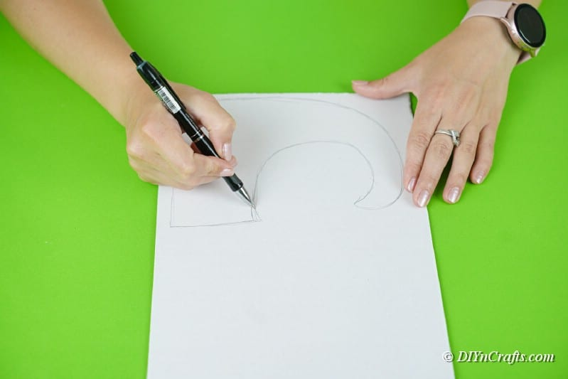 woman tracing on paper