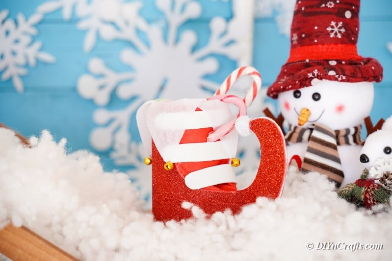 boot sitting in Christmas scene with snowflake