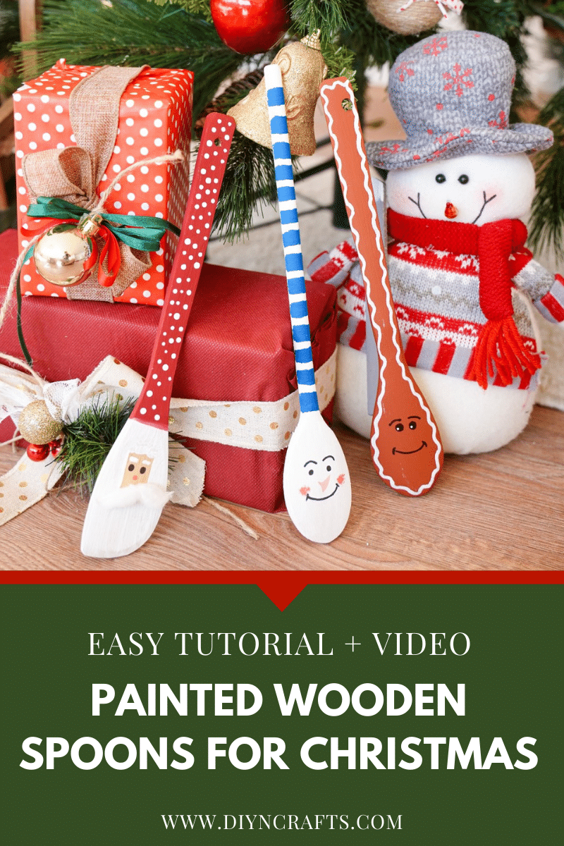 3 Painted wooden spoons under a Christmas tree