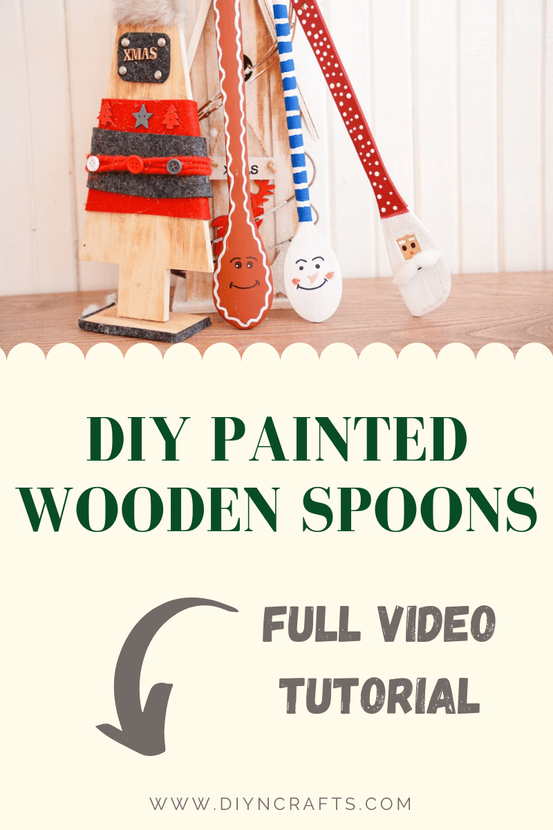 Painted spoons leaning against a wooden tree
