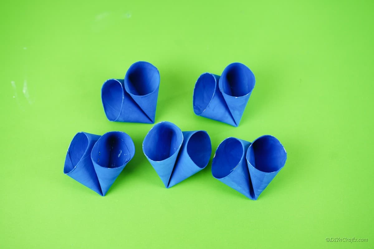 folded blue toilet paper rolls on table