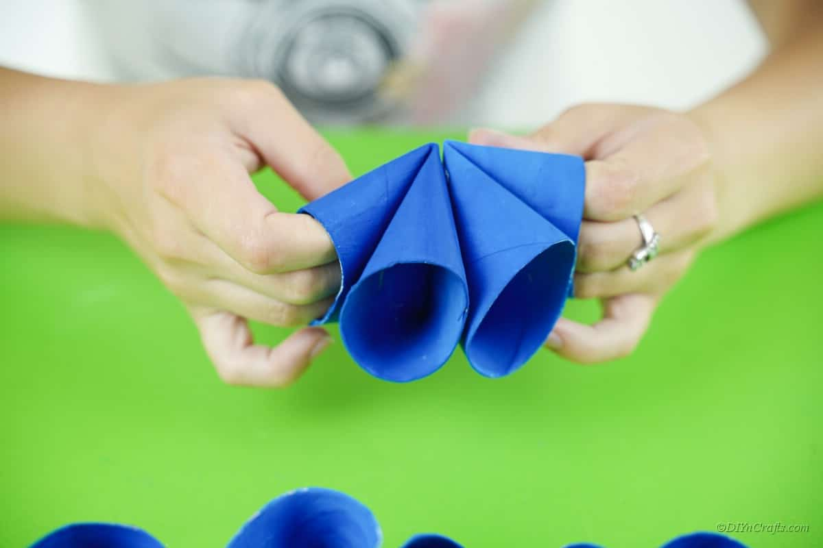 woman holding blue paper craft