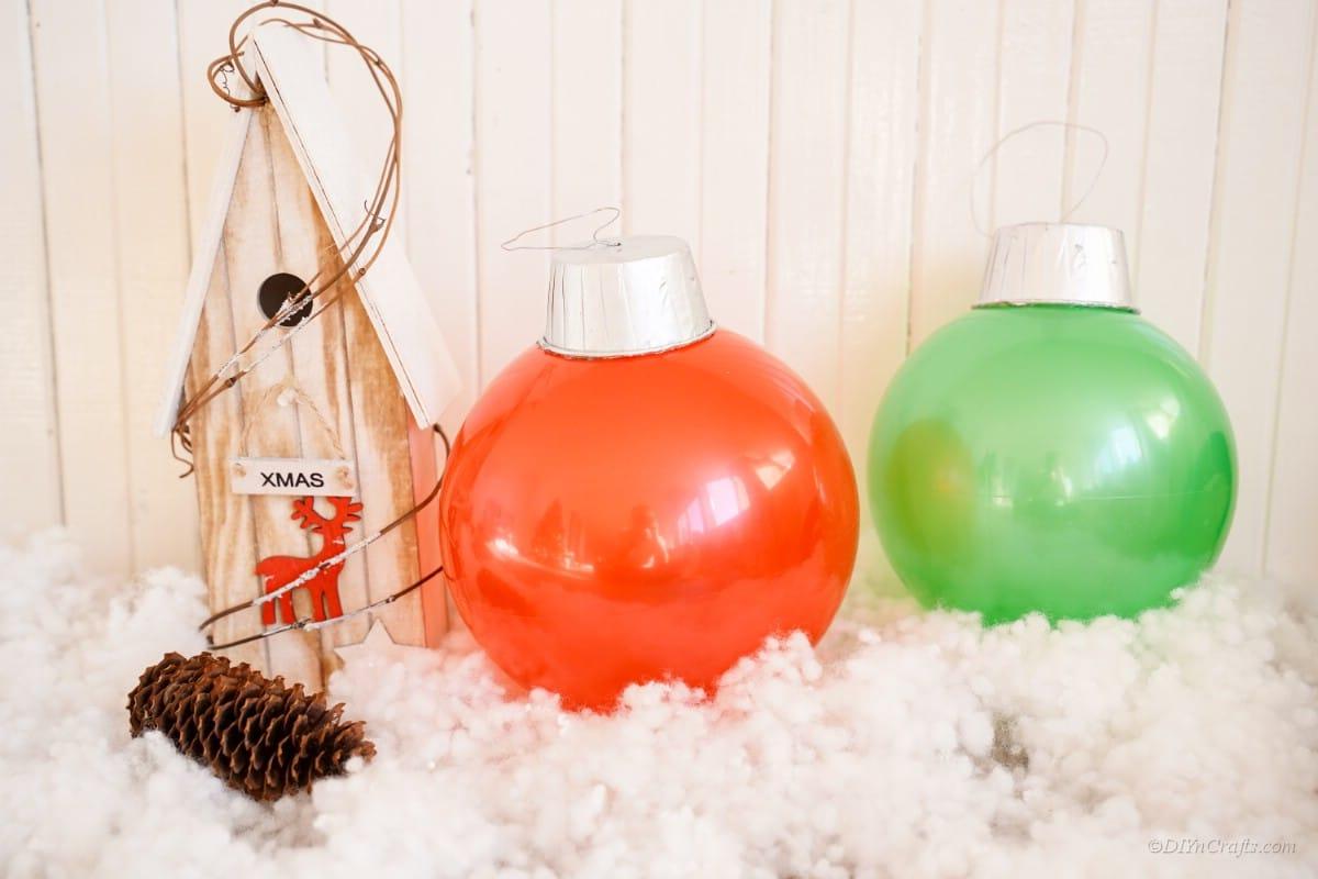 Christmas ornament display with fake snow birdhouse