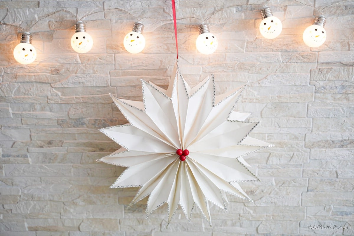 paper bag star craft with lights on wall