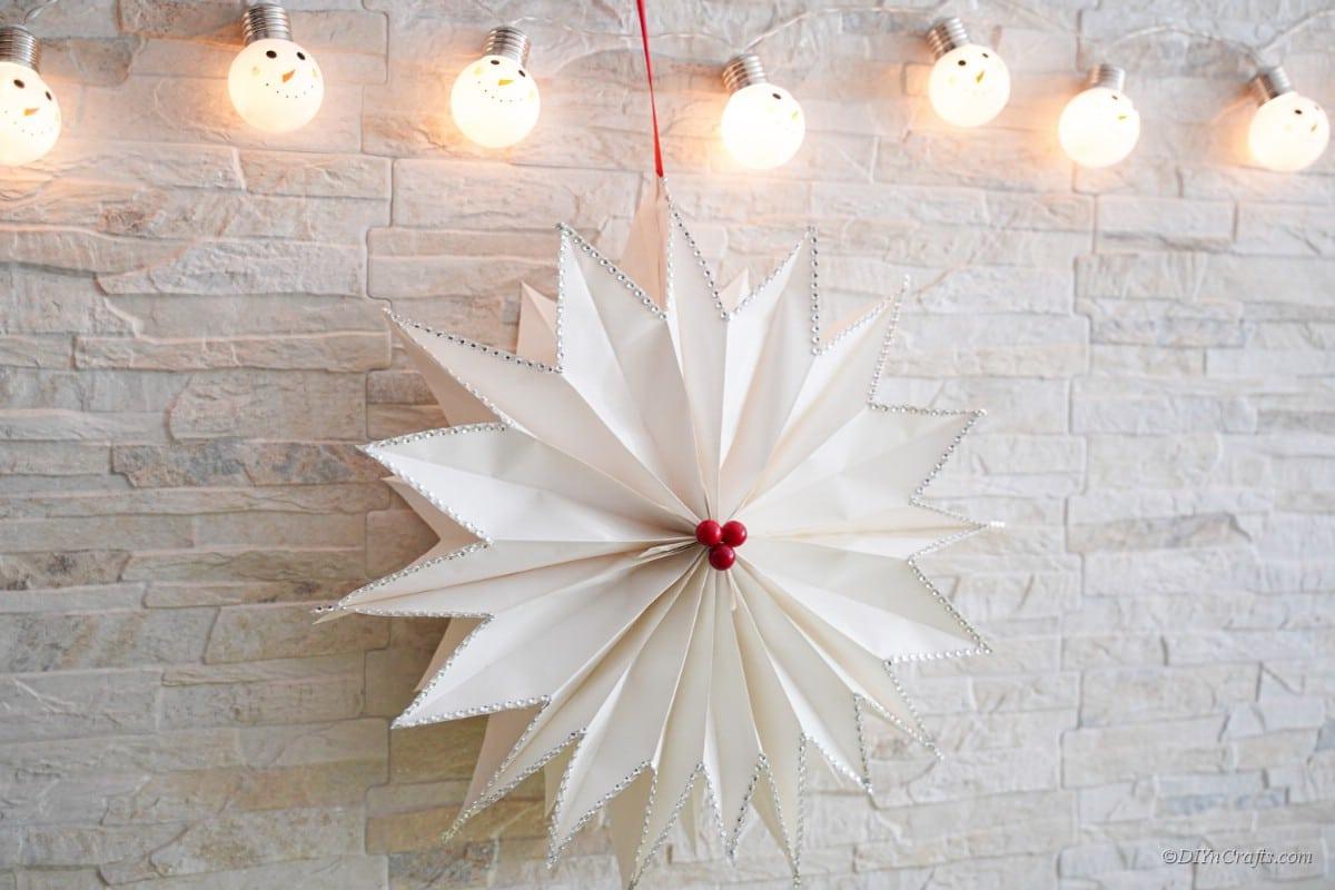 paper star craft hanging under lights