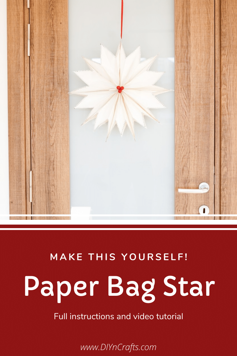 Paper bag star hanging on a door