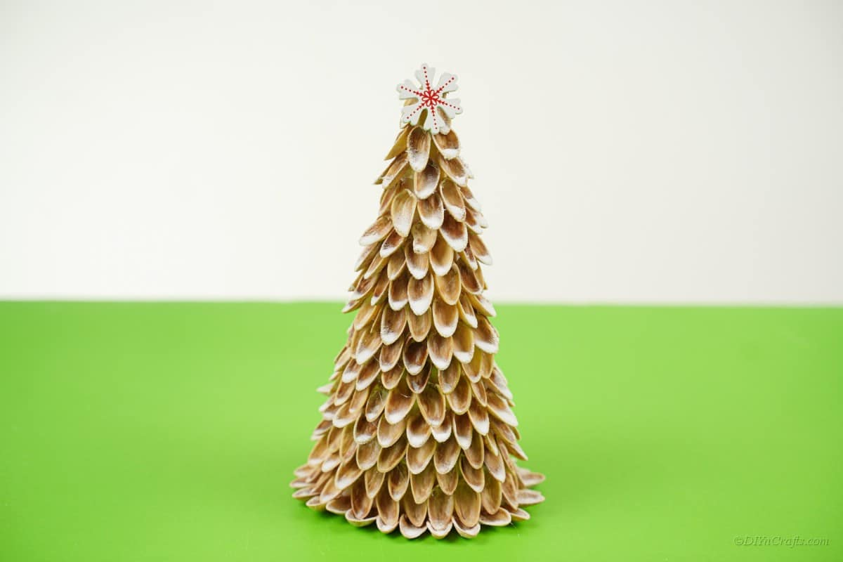 nut craft handmade Christmas tree on green table